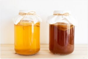 Kombucha in fermenting jars with SCOBY inside